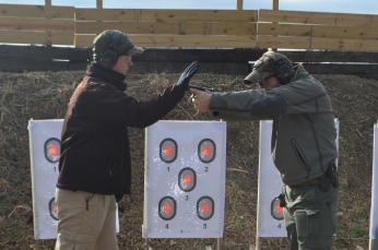 "Showing proper forward aggressive stance with ""simulated"" recoil"