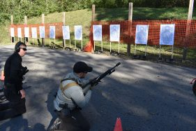 Student working a reload drill from the kneeling position in Tac Rifle